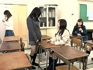 Asian teacher holds back one of her students to eat a littl