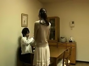 Attractive Japanese housewife has a young man kissing her l