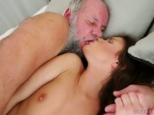 Freaky bearded grandpa eats and fucks lean and svelte young slut on the bed