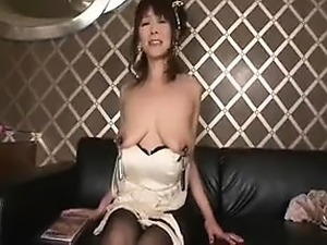 Luscious Oriental mom in hot lingerie puts her saggy boobs