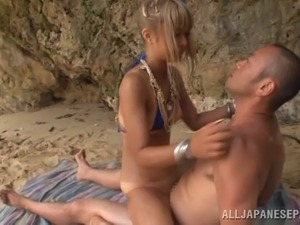 Blazing Asian damsel in sexy bikini giving a smooth blowjob as she gets...
