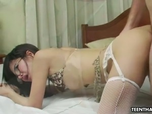 Lovely brunette cutie in glasses blows dick on POV porn video
