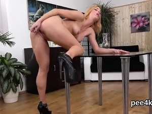 Charming kitten is peeing and pleasuring shaved honey pot