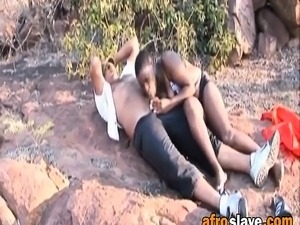 Busty African Slave Gives Lovely Head Outdoors
