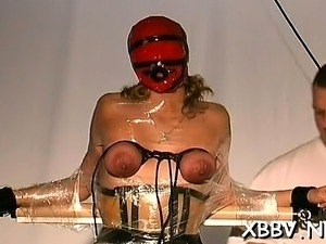 Undressed woman shows off in complete breast slavery x video
