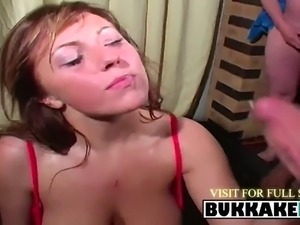brunette hottie blowing two dicks