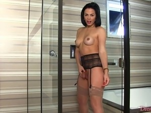 Sexy shemale Bruna Castro takes a piss in the shower