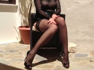 This woman knows how to look sexy and I look to stare at her nylon encased legs