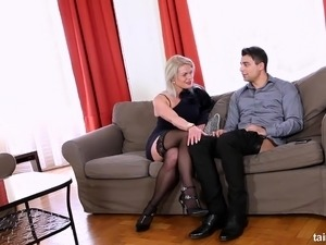 Business woman cheating on her husband on the sofa