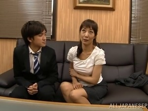 Attractive mature Asian cowgirl with natural tits moaning while masturbating