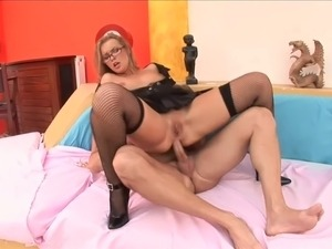 sexy milf wearing glasses and fishnets takes it in all holes