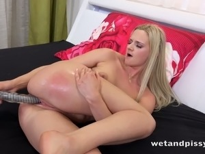Incredibly horny babe Katy Sky fucks her pee soaked muff with her sex toy