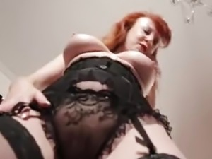 Busty mature redhead mistress plays with her pussy close up