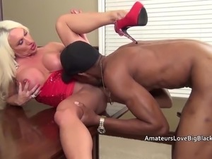 Muscular mature with swollen clit fucks big black cock