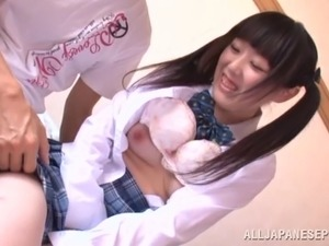 A pigtailed Japanese teen in a uniform gets cowgirl fucked