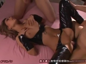 Babe in a latex outfit opens her legs for a nasty fuck