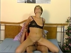 Sweet classic European babe bounces on a dick of her dark skin lover