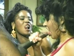 Shiny black man feeds ebony sluts with his fat big black rod