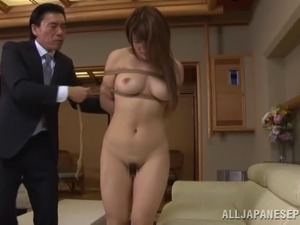 Attractive Japanese damsel in bondage delivering stunning blowjob in close up...