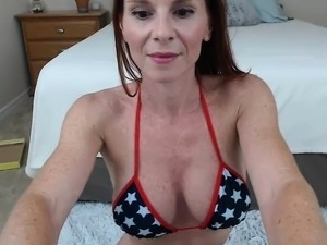 Redhead mature MILF strips on live webcam