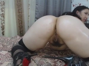 green brunette caresses hairy pussy
