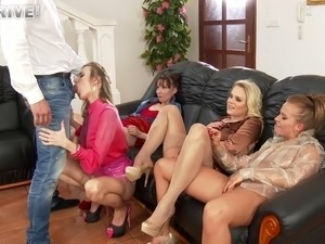 Stocking-clad porn star with a shaved pussy enjoying a hardcore gangbang