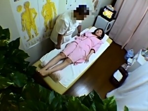Petite Japanese babe is made to cum on the massage table
