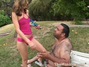 Skinny girl feeding a fat guy and fucking him outdoors