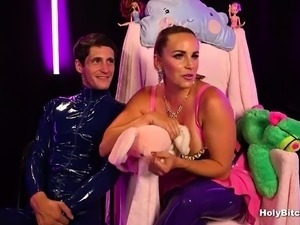Busty mistress in latex pegging dude