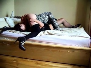 Two lustful crossdressers exchange blowjobs on the bed