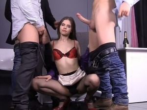 Skinny girl is double penetrated in hardcore gangbang session
