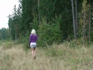 Shameless teen Yulia takes off her panties and pisses in the field