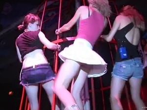 Girls wearing miniskirts get caught on voyeur's cam in a club