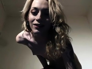Slim blonde shemale exposes her body and strokes her cock