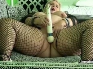 PAWG in fishnets wets the couch