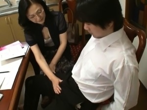 Lustful Japanese milf has a young guy satisfying her needs