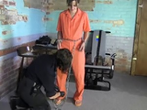 She shackles her prisoner