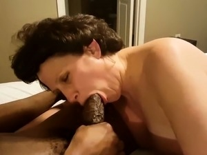 Mature brunette has a hung black stud cumming in her mouth