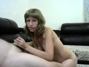 Horny mature wife puts her hands and lips to work on a dick
