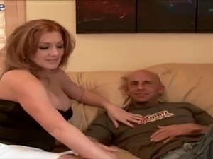 Sexy busty redhead blows dick and gets her shaved twat fucked on sofa