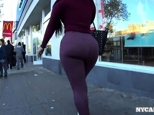 Big booty amateur babe in tight purple pants goes for a walk