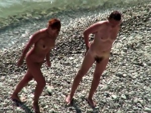 Amateur video of Couple at a public beach nude