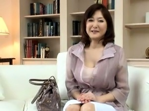 Mature Japanese lady with big hooters has fun with two boys
