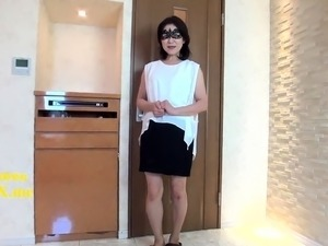 Masked Japanese mom has fun with sex toys and a meat shaft