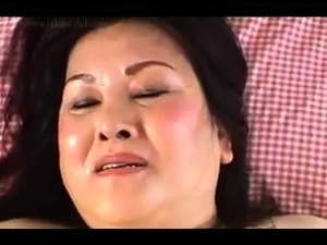 Chubby Japanese mom relinquishes her pussy to a young cock